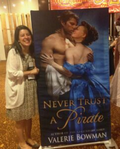 Valerie Bowman with a cutout of her book, Never Trust a Pirate