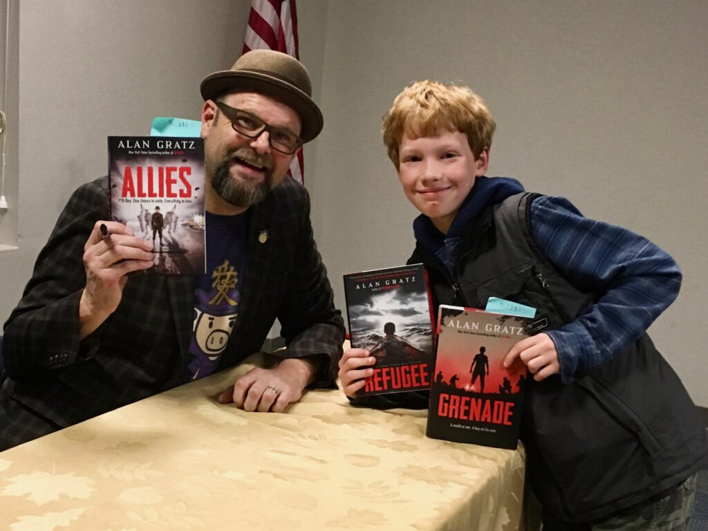 M.J.'s son with author Alan Gratz at a book signing.